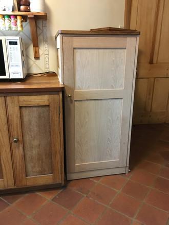Reclaimed oak fridge cabinet.