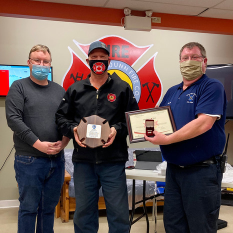 Firefighter Duane Lee receiving his 35 year provincial medal and certificate as well as a plaque from the Town of Saint Andrews for his dedication to the St. Andrews Fire Department. From L to R: Town CAO Chris Spear, Firefighter Duane Lee and Fire Chief Kevin Theriault