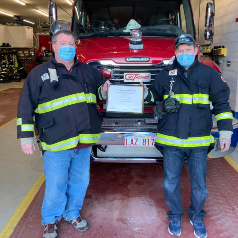 Lieutenant Greg Callaghan (R) receiving his Level II Certification from Chief Kevin Theriault