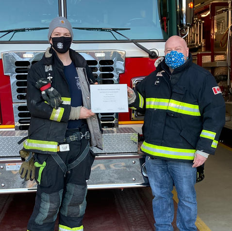 Firefighter Vinny Parker (L) receiving his Level II Certification from Lieutenant Tom Parker