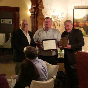Lieutenant Tom Parker receiving his 20 year federal medal for his dedication to the St. Andrews Fire Department. From L to R: Lieutenant Tom Parker, Chief Kevin Theriault and Mayor Doug Naish