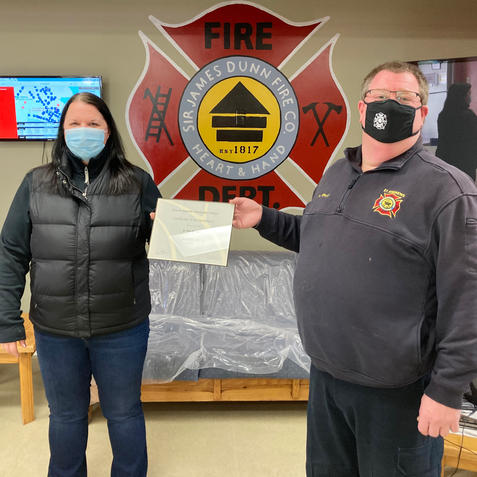 Firefighter Joann Haughn receiving her Level II Certification from Chief Kevin Theriault
