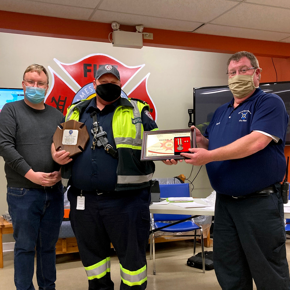 Assistant Chief Jimmy Craig receiving his 25 year provincial medal and certificate as well as a plaque from the Town of Saint Andrews for his dedication to the St. Andrews Fire Department. From L to R: Town CAO Chris Spear, Assistant Chief Jimmy Craig and Fire Chief Kevin Theriault