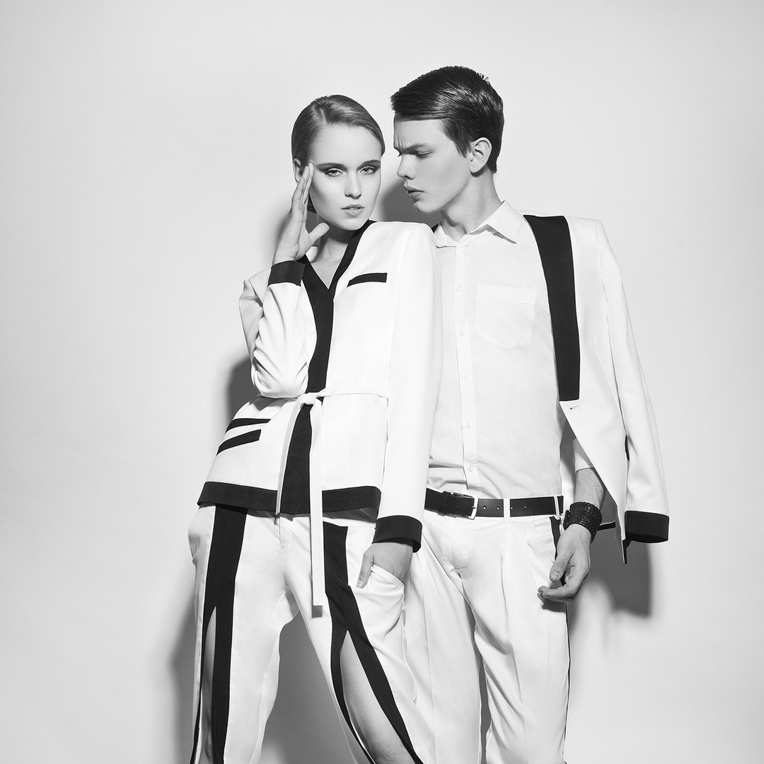 Models in black and white suits