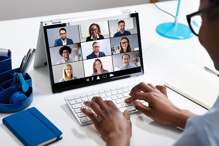 Woman Working From Home Having Group Vid