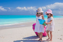 Little lovely girls with big suitcase an