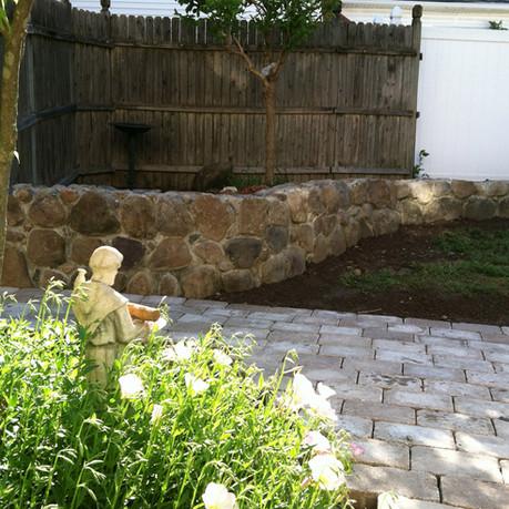 Brick Sidewalk and Stone Wall