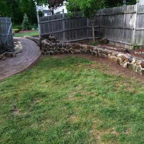 Brick Sidewalk and Small Stone Wall