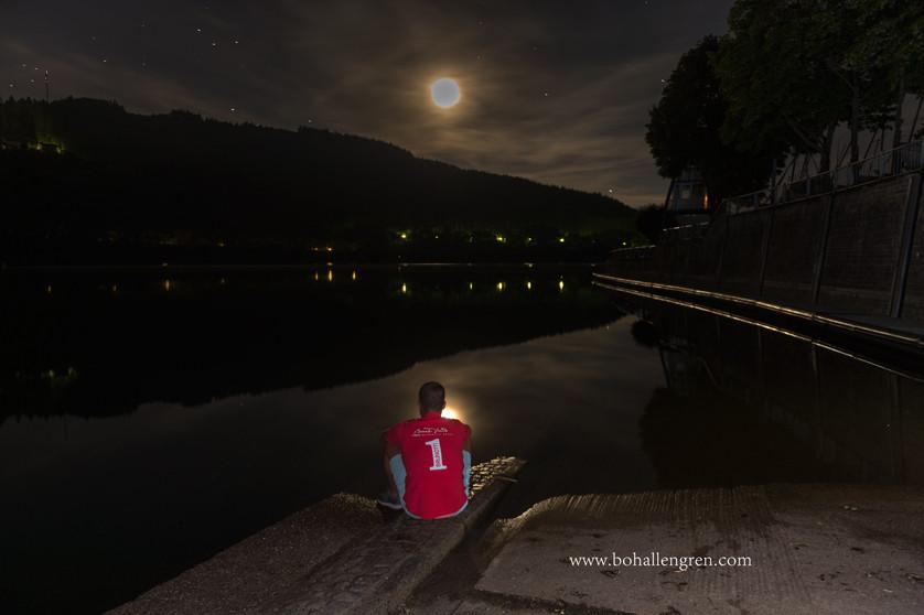 Moonlight watch by lake