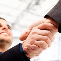 bigstock-Business-people-shaking-hands--26977514