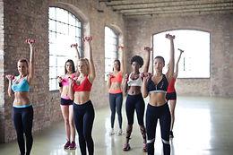 women-having-exercise-using-dumbbells-90