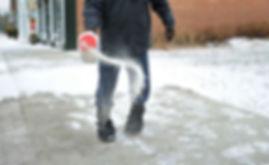 Spreading Salt Sidewalk.jpg