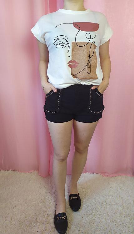 Short in jeans con borchie