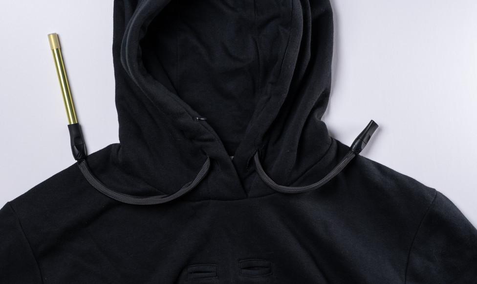 A hoodie with hidden vape hose disguised as pull strings.