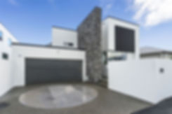 Modern Black and White House with Natural Stone Feature and Driveway with Vehicle Turntable