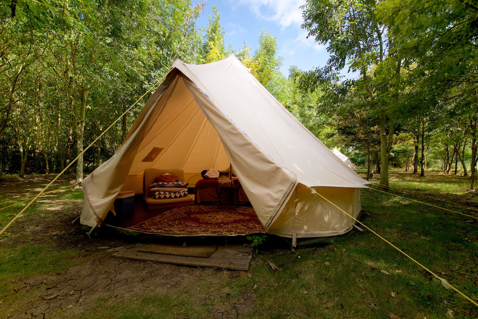 bell tent looking in woodland escape CGH