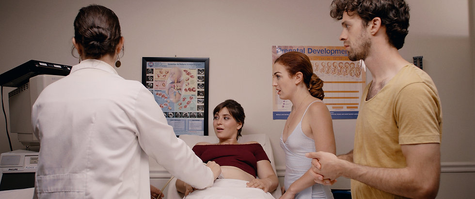 Margarita Zhitnikova (as Maggie), Stacey Maltin (as Chloe), Jay DeYonker (as Gus), and Mischa Ipp (as Doctor Serena Long)are in an obstetrician's office. The doctor does an ultrasound on a pregnant Maggie as Chloe and Gus watch in Triple Threat Film,Courtesy of Besties Make Movies