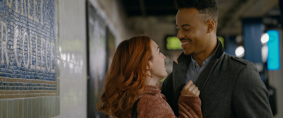 In a subway station Stacey Maltin (as Chloe) and Mark St. Cyr (as Caleb) lovingly hold hold each other in Triple Threat Film, Courtesy of Besties Make Movies