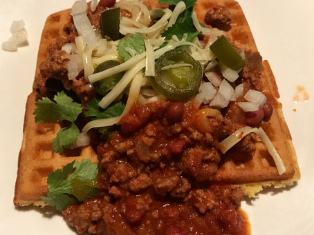 Cornmeal Waffle with Chorizo and Beef Chile on top