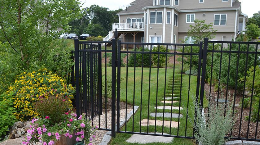 Ornamental Fence and Stone Pavers 870x48