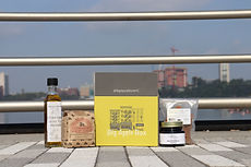 Sample box with coffee, jam, olive oil, and cinnamon sticks