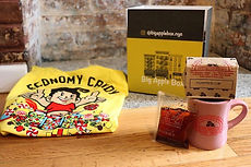 Sample box with Economy Candy t-shirt, Porto Rico Coffee and Mug, Xi'ans Famous Foods Chili Oil