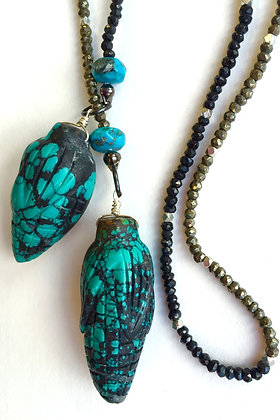 Turquoise, pyrite and black spinel