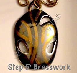 Silver pendant with brass made with silver clay