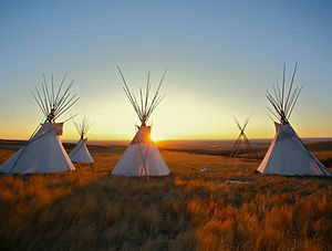 Native North American tipis at sunrise o