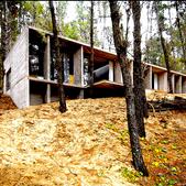 Concrete house hillside.png