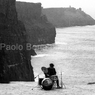 Solitary drummer at the Cliffs of Moher