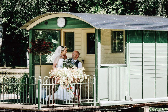 just married couple posing on a train carriage