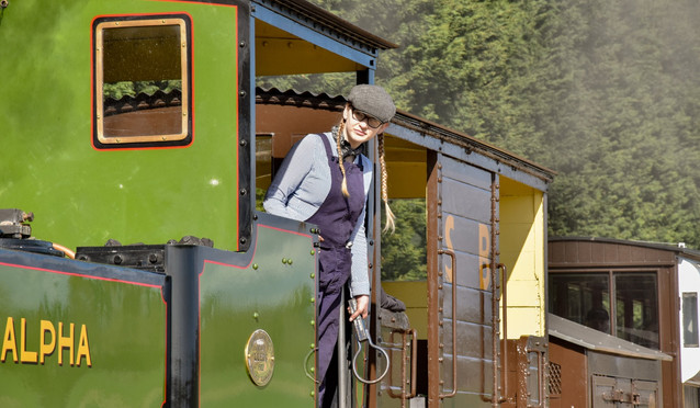 Young female train driver