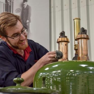 Engineer taking pride in cleaning engine