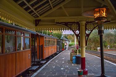 Vintage steam engine at platform at Statfold Barn Railway