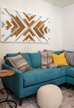 living room couch and wall art