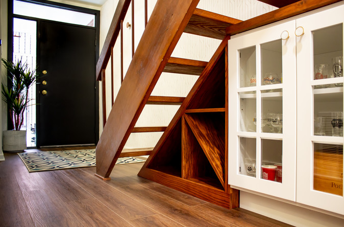 shelf under stairs