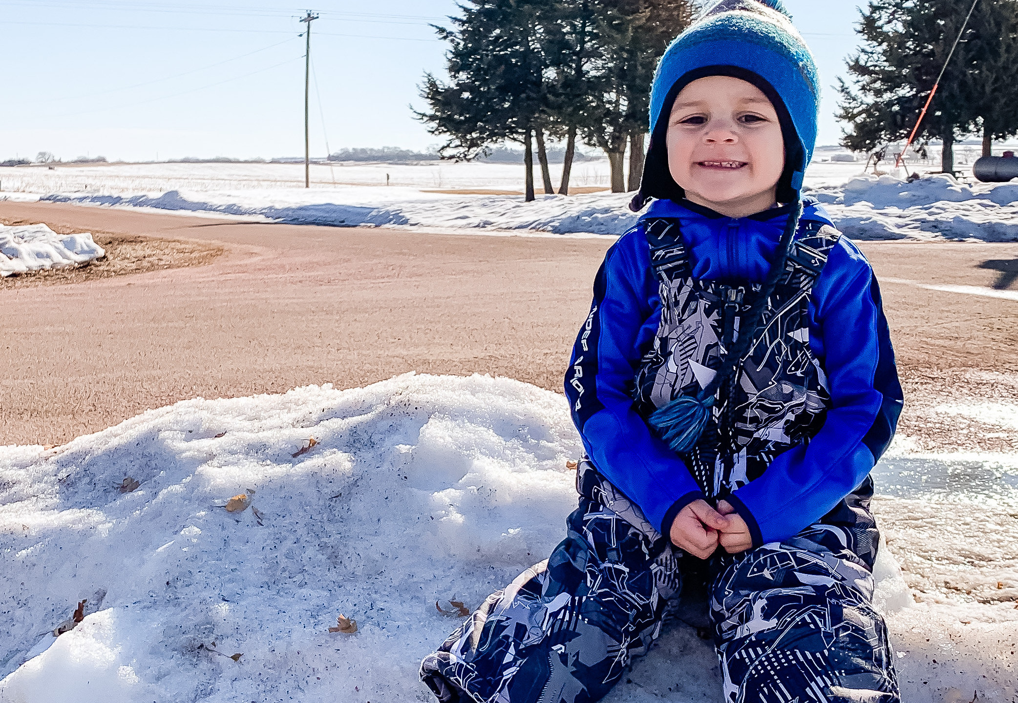 Vander Wollman wishing the snow would melt away. Son of Jeremy and Kelly Wollman.