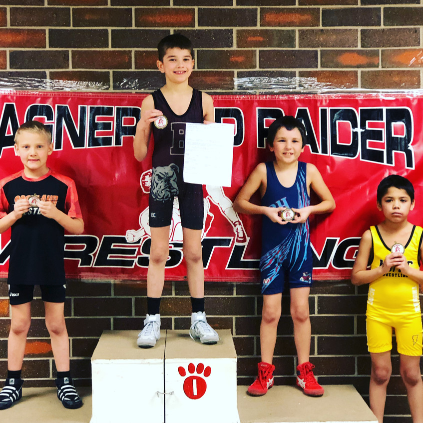 Masen Hausmann (center) took first place at the AAU Wresting tournament in Wagner earlier this season. Masen is the son of Jason and Cari Hausmann of Bonesteel.