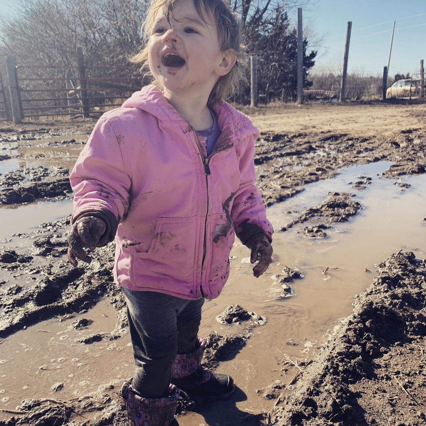 Elizabeth Hall absolutely loving the mud. Daughter of Autumn Anderson and Matthew Hall.
