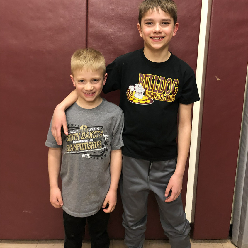 Brysen Bailey (left) and Masen Hausmann (right) had a very successful year wresting with the Burke Bulldog AAU team.