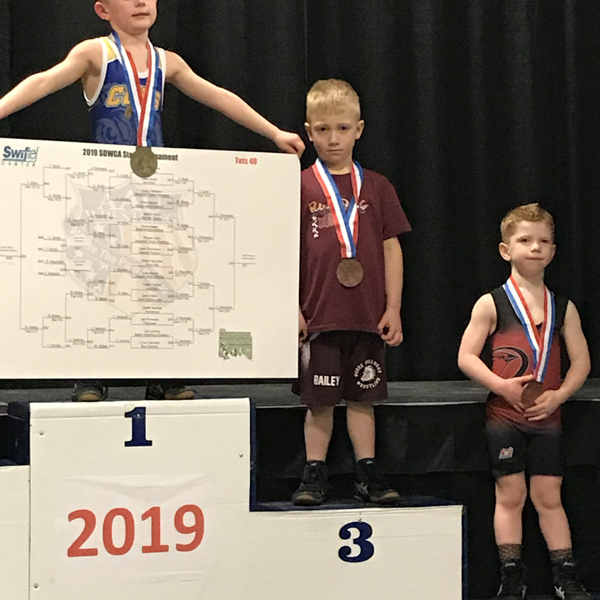Brysen Bailey (center) placed third at the State AAU Wrestling Meet in Brookings on March 16-17. Brysen is the son of Justin and Sarah Bailey of Bonesteel.