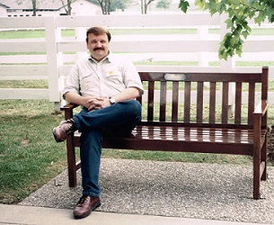 This is a photo on myself sitting on a bench at the Kentucky Horse Parl.