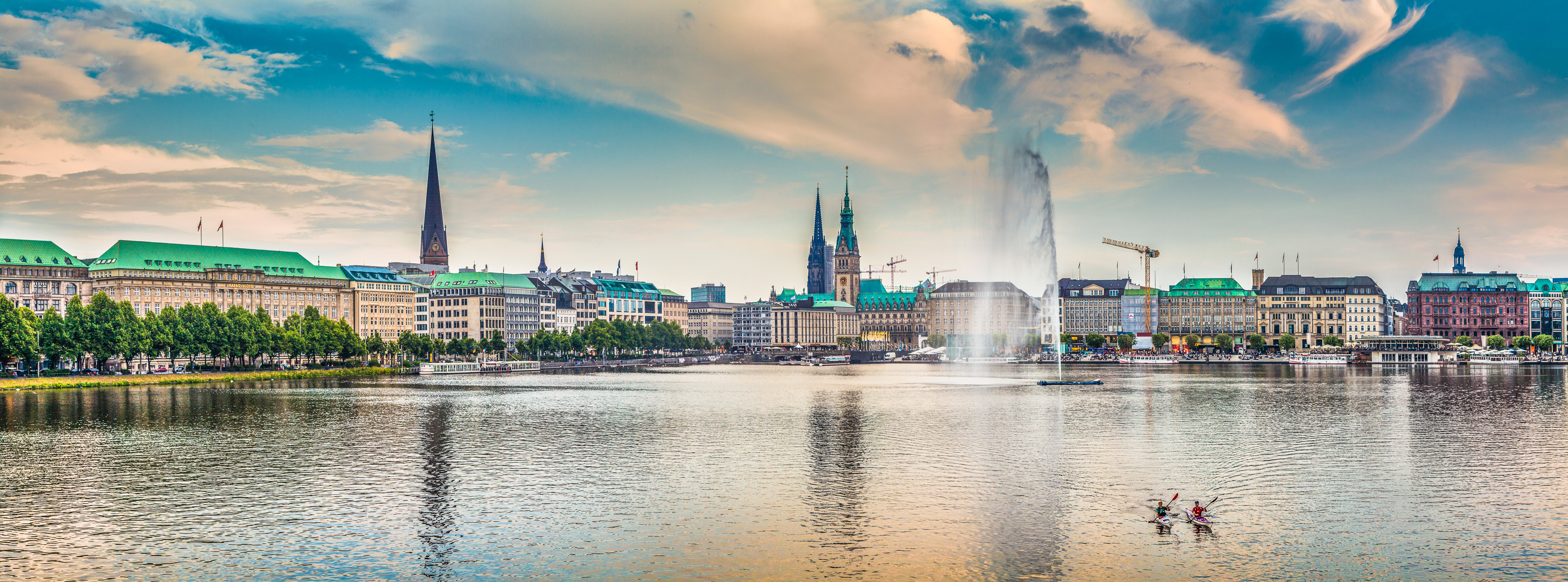Panoramic view of famous Binnenalster (Inner Alster Lake) in golden evening light at sunset, Hamburg