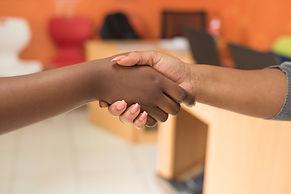 two-people-shaking-hands-955388.jpg