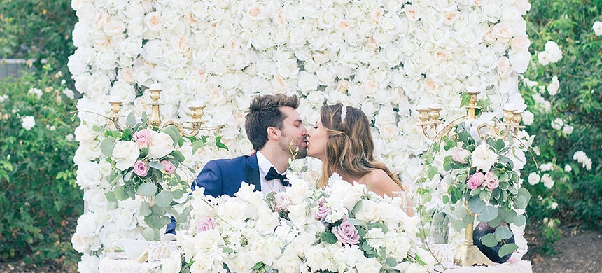 chic-wedding-with-a-lush-floral-wall-bac