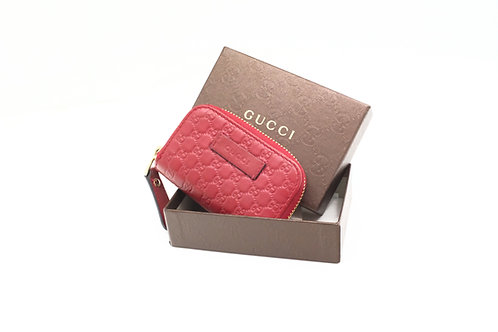 Gucci Zipped Coin Case in Red Micro Guccissima Leather