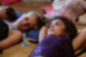 Children lying down listening to music