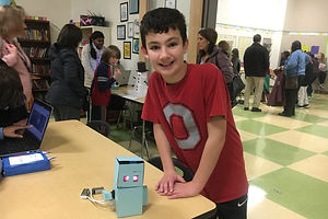Student displaying a project