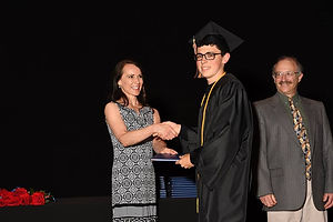 Graduate receiving his diploma